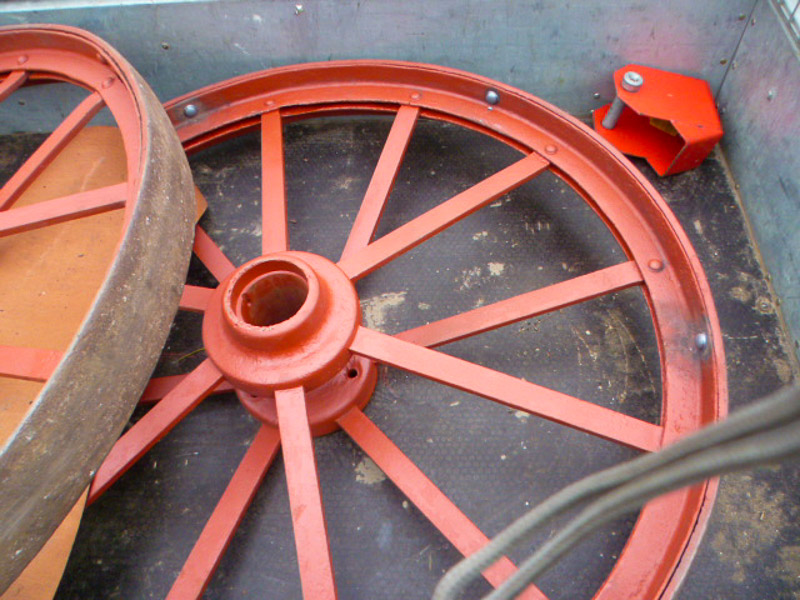 Hot - rivetting repairs to portable steam engine wheels.